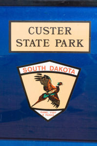 Custer State Park sign, Black Hills, Wyoming, USA by Sergio Pitamitz