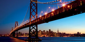 San Francisco and Bay Bridge at Sunset by Dibrova