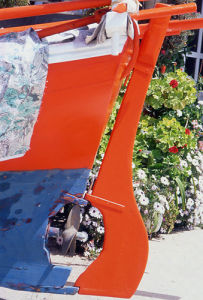 Freshly-painted red rudder by Kim Sayer