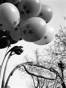 Balloons by Metro Station, Paris 1963 by Alan Scales