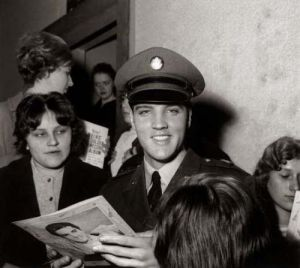 Elvis Presley signs autographs, March 1962 by Mirrorpix