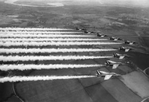 Red Arrows Gnat trainers in formation by Mirrorpix