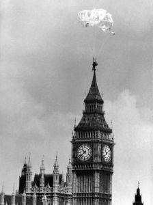 Parachutist passing Big Ben by Mirrorpix
