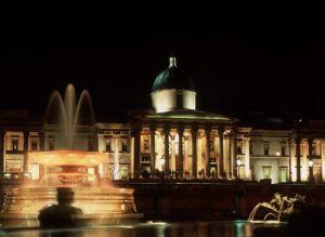 Trafalgar Square lit up at night, London by Mirrorpix