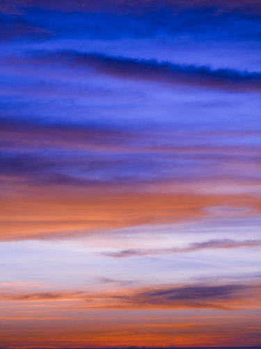 Low angle view of clouds at sunset by Assaf Frank
