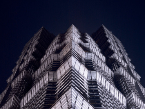 Low angle view of Jinmao tower at night, Shanghai by Assaf Frank