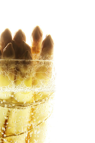 Asparagus in a glass of water by Grolla