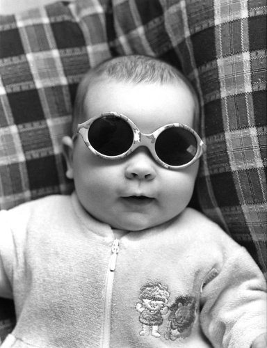 Baby with sunglasses by Gerd Pfeiffer