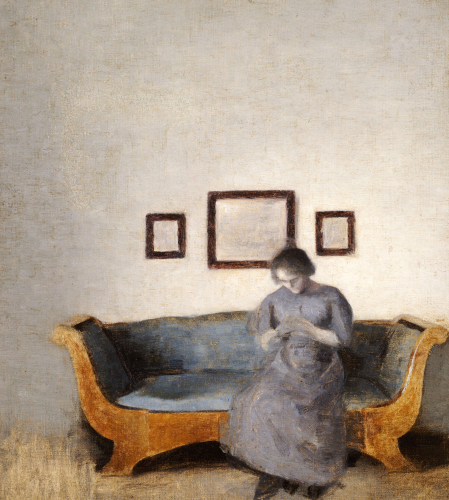 Ida Hammershoi Sitting On A Sofa by Vilhelm Hammershoi