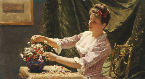A Young Woman Arranging Flowers by Emile Claus