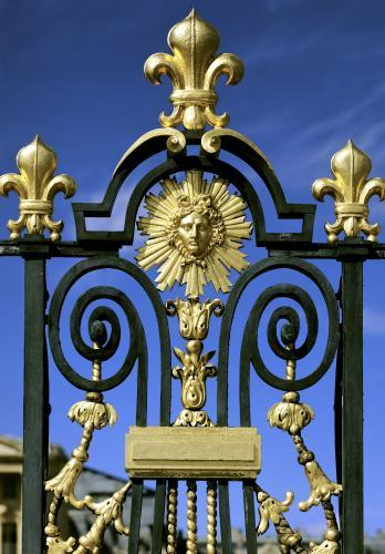 Detail of the Grille d'honneur depicting fleur de lys and the emblem of Louis XIV by French School