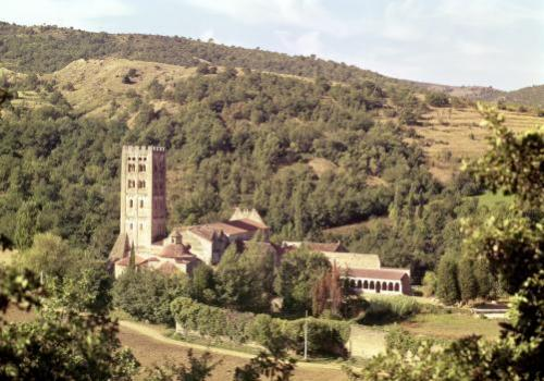 View of the Abbey and the church tower by French School