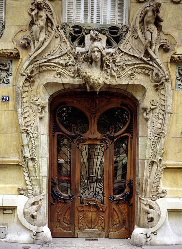 Entrance door to the apartments at 29 Avenue Rapp by Jules Lavirotte