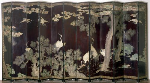 Coromandel screen depicting cranes pine trees and clouds by China