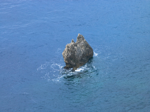 Greece, Rock formation in sea, aerial view by Assaf Frank