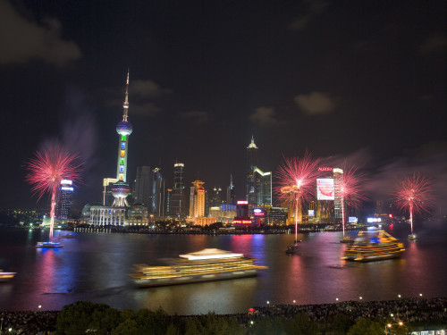 China, Shanghai, Fireworks with skyscrapers at night, elevated view by Assaf Frank