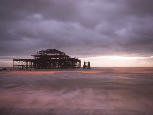Brighton Pier at dusk by Assaf Frank