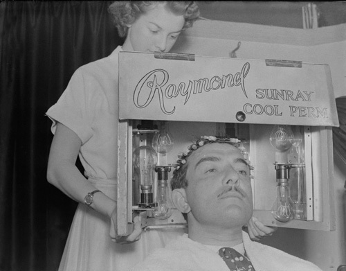 Hair stylist Raymond has poodle cut, 1951 by Mirrorpix