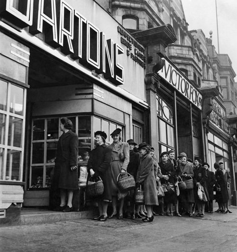 Queuing at the shops, 1950 by Mirrorpix