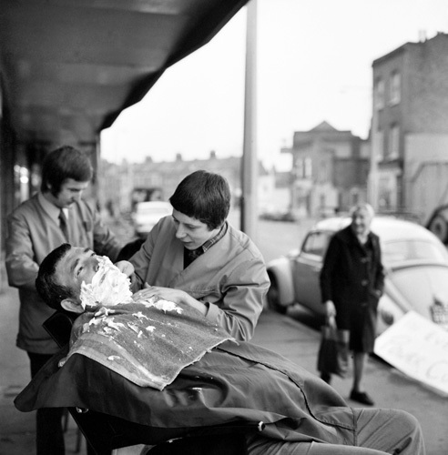 Oudoor barber, Plaistow 1970 by Mirrorpix