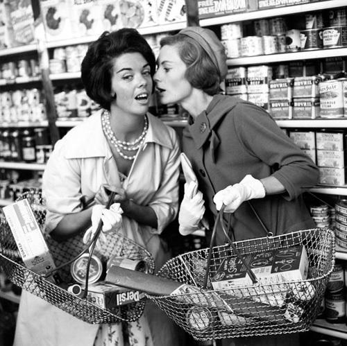 Women whispering in shop, 1960 by Mirrorpix