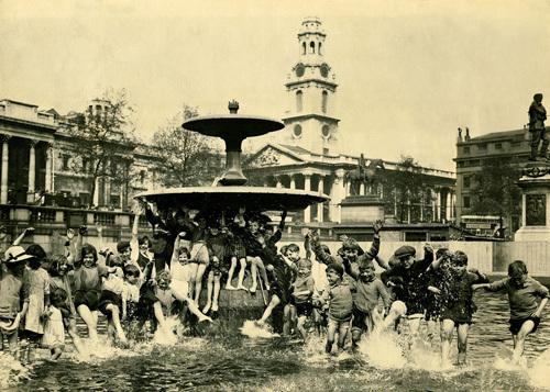 Children in Trafalgar Square fountain, 1920 by Mirrorpix