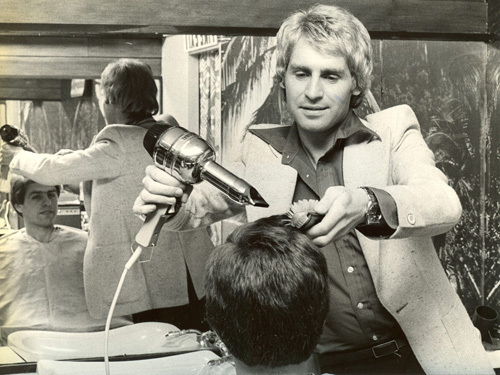 Mens hairdresser with dryer, 1970 by Mirrorpix