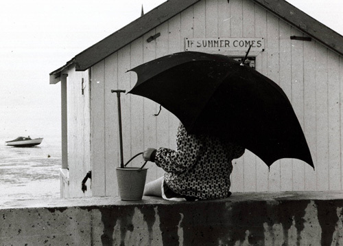 Holidaymaker under umbrella, Thorpe Bay 1970 by Mirrorpix