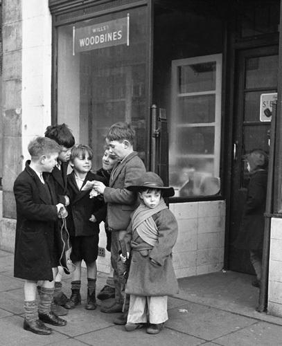 Boys outside shop 1954 by Mirrorpix