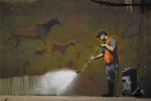 Cleaning Cave Drawings by Street Art