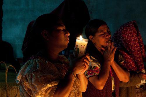 Worshippers, San Francisco church, San Francisco El Alto, Guatemala by Sergio Pitamitz