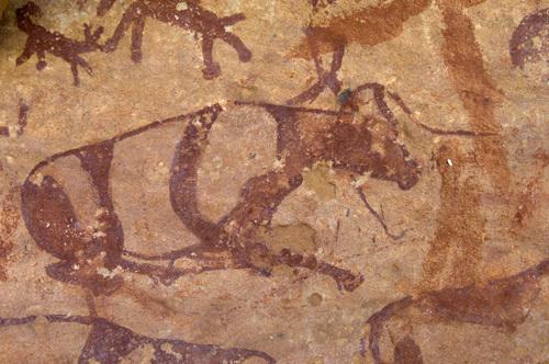 Prehistoric rock paintings, Wadi Teshuinat, Akakus, Sahara desert, Fezzan, Libya by Sergio Pitamitz