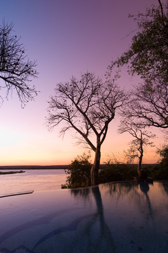 The River Club lodge, sunset on Zambesi River, Zambia by Sergio Pitamitz