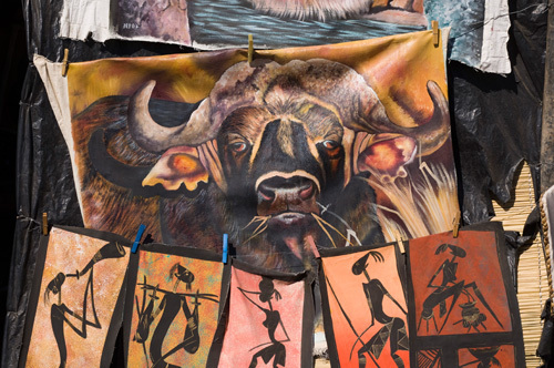 Buffalo print in souvenir shop, Victoria Falls, Zambesi River, Zambia by Sergio Pitamitz