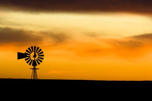 Windmill at sunset, South Dakota, USA by Sergio Pitamitz