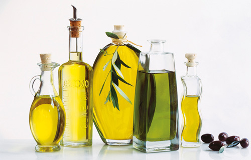 Bottles of olive oil by Atelier
