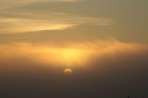 Sun breaking through the fog by Mirrorpix