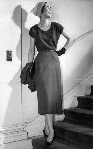 Model wears calf-length dress, 1955 by Mirrorpix