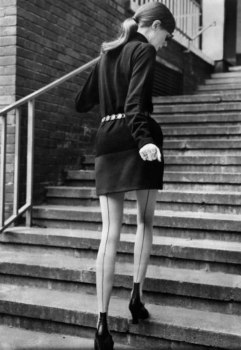 Model walks up steps, 1968 by Mirrorpix