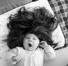Baby with long black wig by Gerd Pfeiffer