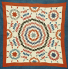 A Pieced Quilted Coverlet by American School