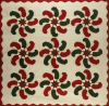 An Appliqued Cotton Quilted Coverlet. American by American School