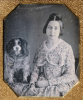 Young Girl With A King Charles Spaniel, Circa 1848 by S.L. Carleton
