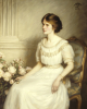 Portrait Of Mary Doris Reed, Seated Half Length, Wearing A White Dress by Henry John Hudson
