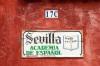 Spanish school sign, Antigua, Guatemala by Sergio Pitamitz