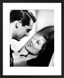 Cary Grant with Katharine Hepburn (Bringing Up Baby) by Hollywood Photo Archive