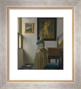 A Young Woman standing at a Virginal by Johannes Vermeer