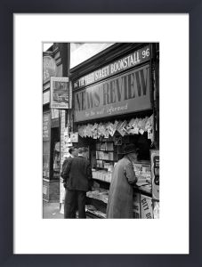 Newspaper vendor in Fleet Street, London 1950 by Mirrorpix