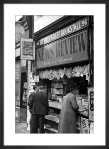 Newspaper vendor in Fleet Street, London 1950 by Mirrorpix