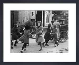 Dancing to a barrel organ, London 1941 by Mirrorpix